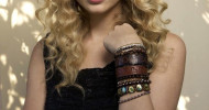 Taylor Swift with long curly hairstyle with straight side bang